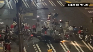 Exclusive video: Street racers flip over, shoot fireworks at car in the University District