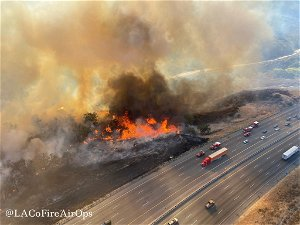 Wildfire forces closure of part of freeway in California