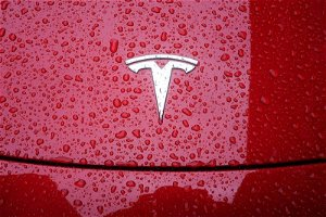 US Tesla to work on EV import tariff reduction in India = related sources
