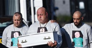 Grieving dad cradles baby son's coffin at funeral after mum charged with murder