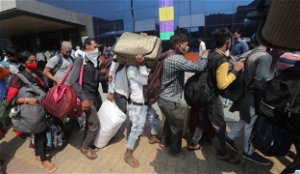 India's worst-hit state imposes strict virus restrictions
