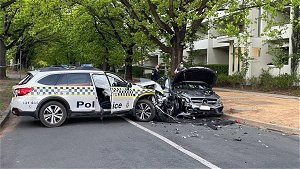 Two people hospitalised after cop car and Mercedes crash