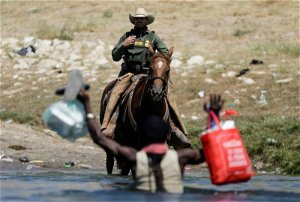 """""""Trapped"""": Migrants collecting food try to evade law enforcement at the U.S.-Mexico border"""