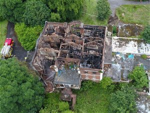 Historic hall gutted by fire is on 'at risk' register