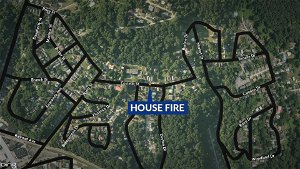 Firefighters battling large brush fire in Queens