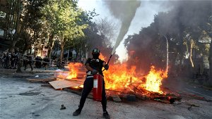 Chile: Protesters clash with police two years after landmark uprising - as election race hots up
