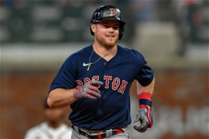 Arroyo's pinch slam sends surging Red Sox past Braves, 10