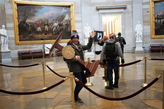 The smiling man seen carrying Pelosi's lectern in Capitol riot? He's from Florida