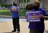 As Covid-19 cases surge, health care workers say PPE is still a struggle