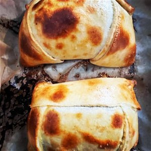 Get down with Don Pablo's big Chilean empanadas at Monday Night Foodball - Chicago Reader