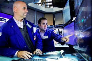 Stock futures are flat ahead of major earnings reports on Tuesday