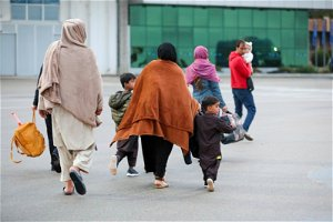 Secrecy shrouds Afghan refugees sent by US to base in Kosovo