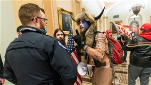 Arizona man who wore horns in Capitol riot to remain jailed
