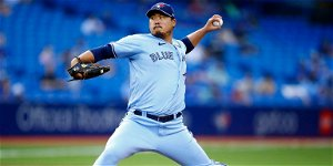Ryu wins 1st Toronto start in Canada as Jays top Indians 7
