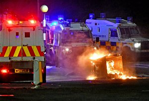 Petrol bombs and bricks hurled at police in third night of violence in Northern Ireland