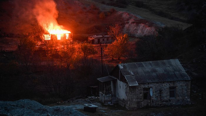 Azerbaijan hits out at Armenians burning their homes as they flee conquered territory