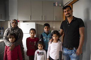 Syrian family reunited, against the odds, in Greece