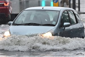 UK weather: DLR station underwater and flooding across London - as thunderstorms to continue into Monday