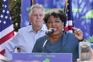 Abrams targets Black churchgoers during campaign stops for McAuliffe in Virginia