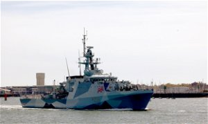 """China says U.K. """"flexing muscles"""" after Britain commits two warships to Asia"""