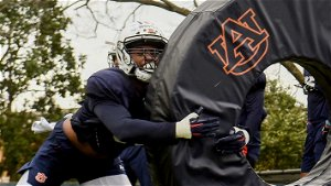 Now a father, Auburn LB Chandler Wooten is happy to be a football player again