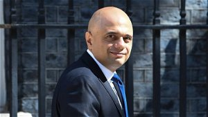 UK minister apologises for urging people not to 'cower from' COVID