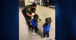 Sisters aged 3 and 5 filmed being dumped over border wall will be reunited with parents in New York