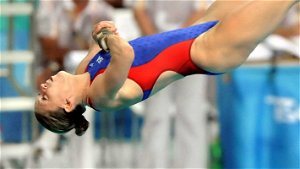Laura Wilkinson, mother of four, pushing for an Olympic diving comeback at age 43