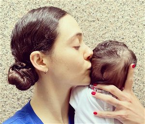 Emmy Rossum makes vaccine plea as she shares first photo of her baby: 'Stop being an irresponsible idiot'
