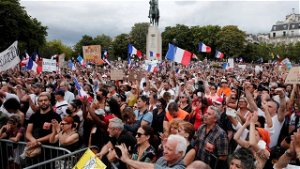 French parliament approves COVID-19 passes for restaurants, domestic travel