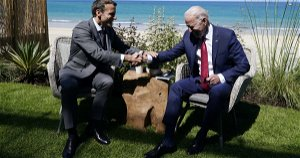 Macron gets tres handsy with Biden and takes a shot at Trump during G