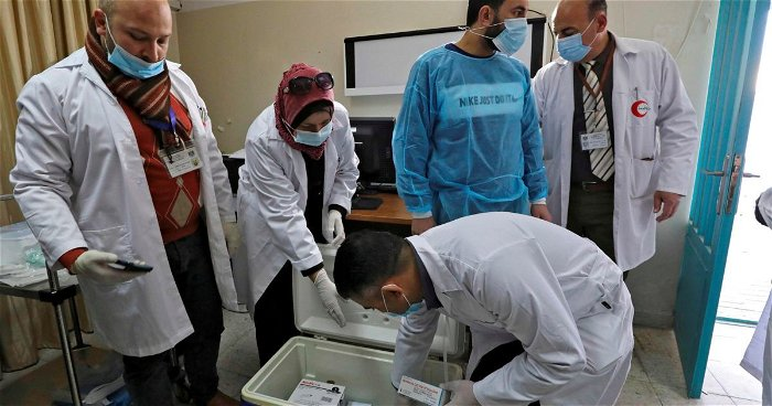 Israel says it shared some COVID vaccines with Palestinians, Honduras