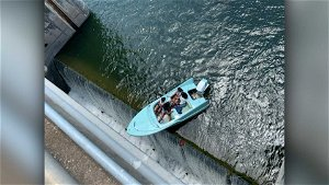 Boaters come dangerously close to tipping over on a Texas dam