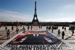 Activists disrupt Paris climate finance meeting before COP26
