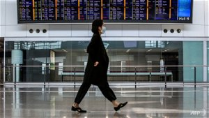Hong Kong to tighten COVID-19 rules, seeks to open to China