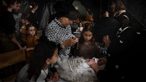 AP PHOTOS: Jews redeem firstborn son in ancient ceremony