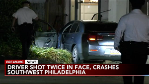 Driver shot in the face, crashes into building in Southwest Philadelphia