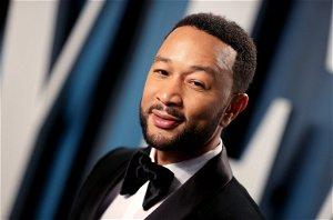 Street musician stunned by John Legend as she sings his hit