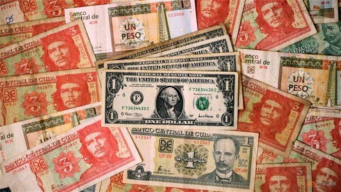 Cuba suspending cash bank deposits in dollars, citing US sanctions