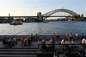 Australia eases COVID-19 travel advisory ahead of border reopening