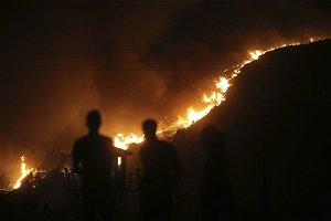 Wildfires burn for a 7th day in coastal areas of Turkey