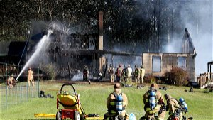 Homeowners, firefighters escape as Rochester home collapses in 4-alarm blaze