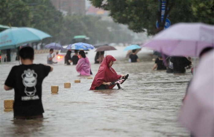 From China to Germany, floods expose climate vulnerability
