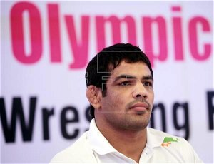 The fall of Indian Olympic wrestling star accused of murder