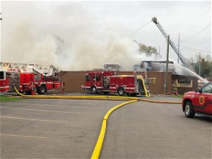 UPDATE: One firefighter taken to hospital after fire at Dispatch Sports Pub & Grill in Lansing Twp